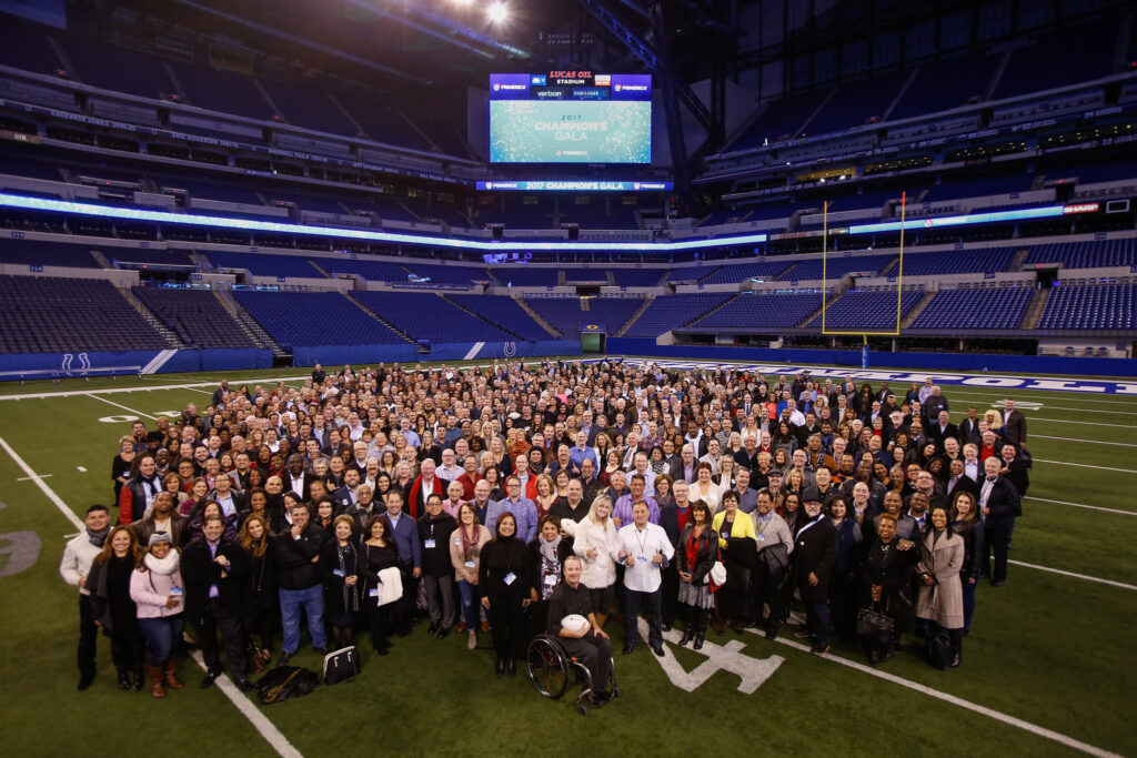 Photo of senior leaders on the field of the Lucas Oil Stadium
