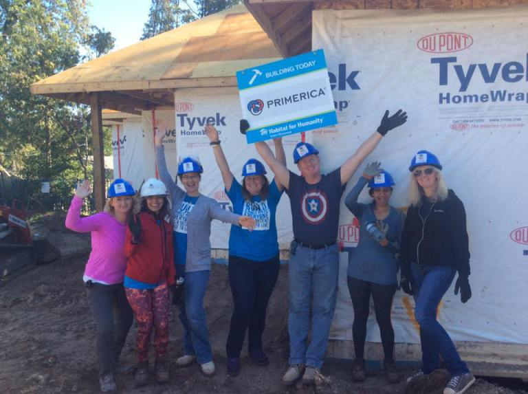 Photo of seven Primerica Canada employees at Habitat for Humanity constructions site